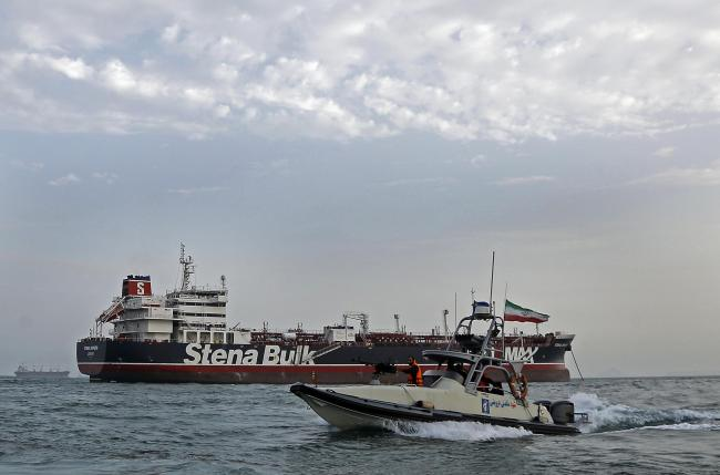 An Iran Revolution Guard speedboat moves around British-flagged oil tanker Stena Impero