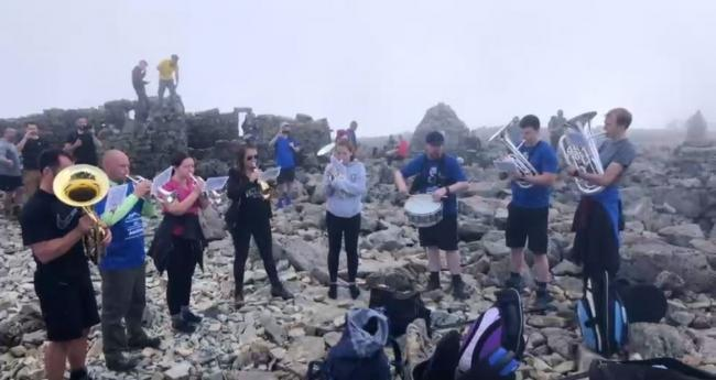 Brass band raise £1,400 with performance up Ben Nevis