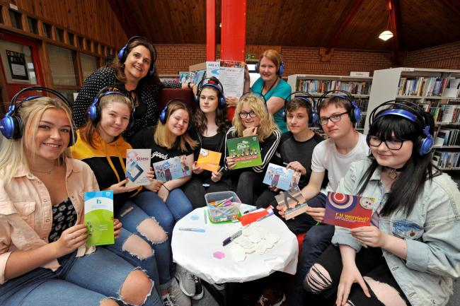 Families enjoy a free fun day to raise health awareness at library