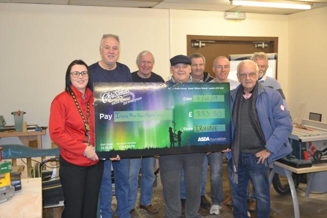 Irvine Newtown Men's Shed recieve cheque from Asda Irvine