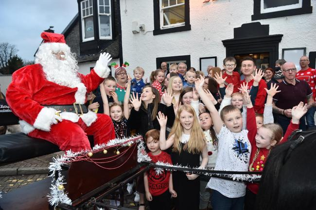 Santa meets the youngsters outside The Turf