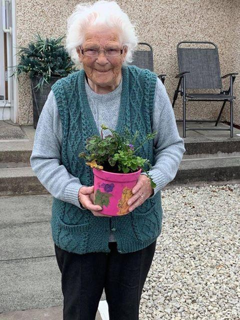 Irvine Times: Resident pleased to receive a special plant pot.