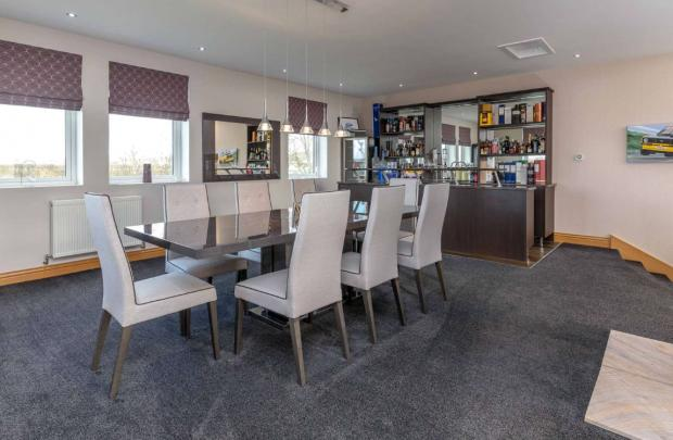 Irvine Times: The property includes a bar (Credit: Savills)