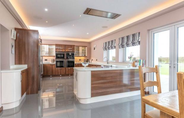 Irvine Times: The home has a spacious kitchen (Credit: Savills)