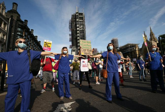 NHS workers march from St Thomas' Hospital to Downing Street (Yui Mok/PA)
