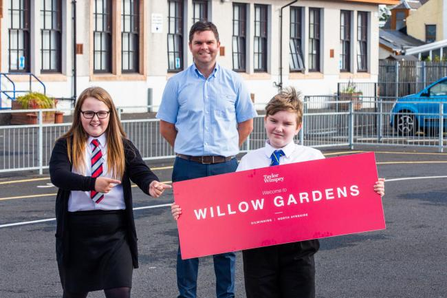 Abbey pupils reveal signs after housing development named Willow Gardens