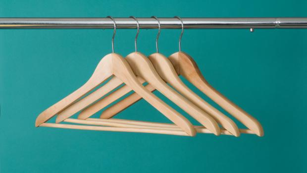 Irvine Times: Wooden hangers are sturdy enough for heavyweight garments. Credit: Getty Images / Spiderstock