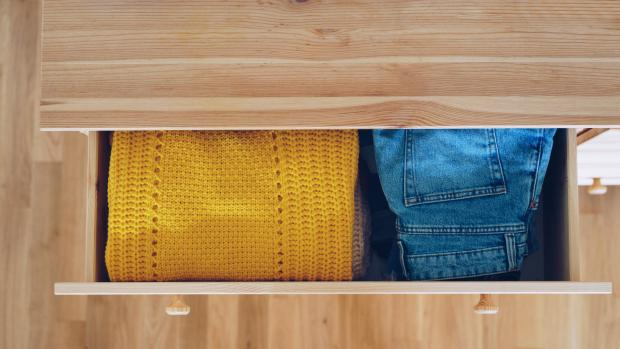 Irvine Times: Rotate jumpers from the back of the drawer to the front periodically, giving them a chance to breathe and regain their shape. Credit: Getty Images / Xsandra