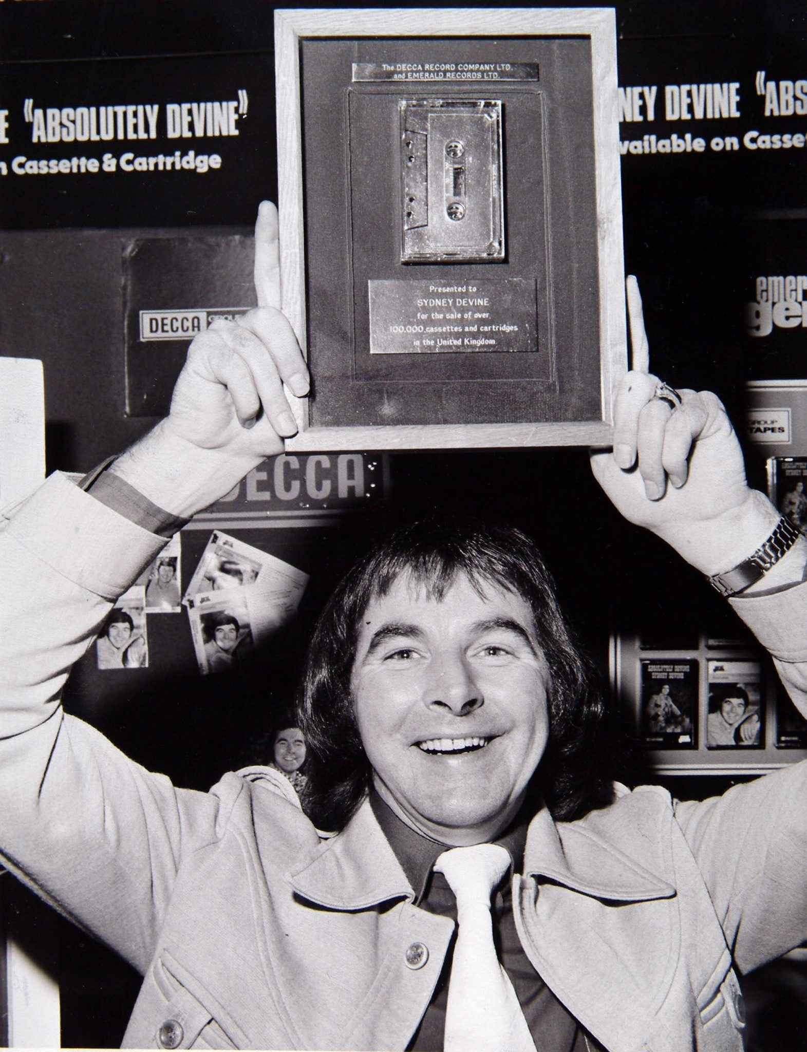 SINGER SYDNEY DEVINE WITH HIS GOLD CASSETTE. 1975. Pic: Herald and Times