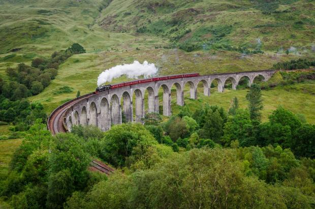 Irvine Times: View of a steam train on a famous Glenfinnan viaduct, Scotland; Shutterstock ID 154641122; PO: THE HERALD MAGAZINE ; Job: TRAVEL