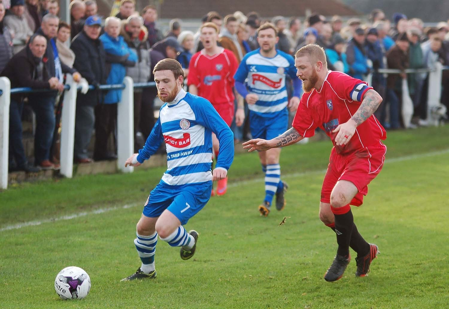 DOUBLE HERO: Carlo Monti, pictured left in action against Irvine Meadow in a previous match, scored both Buffs' goals.