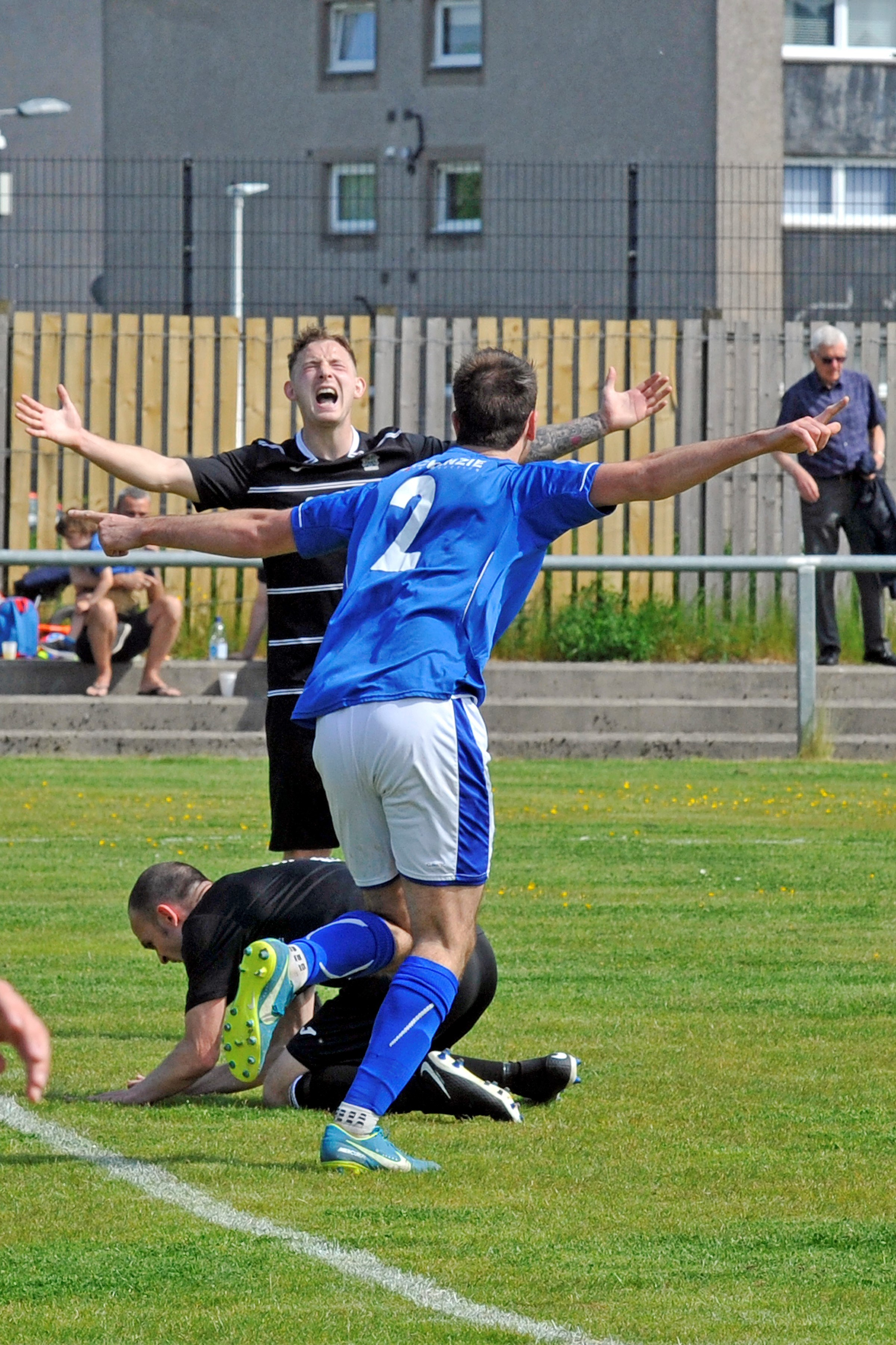 VITAL STRIKE: Celebrations on Saturday as Ben Carson puts Irvine Meadow ahead against Glencairn.