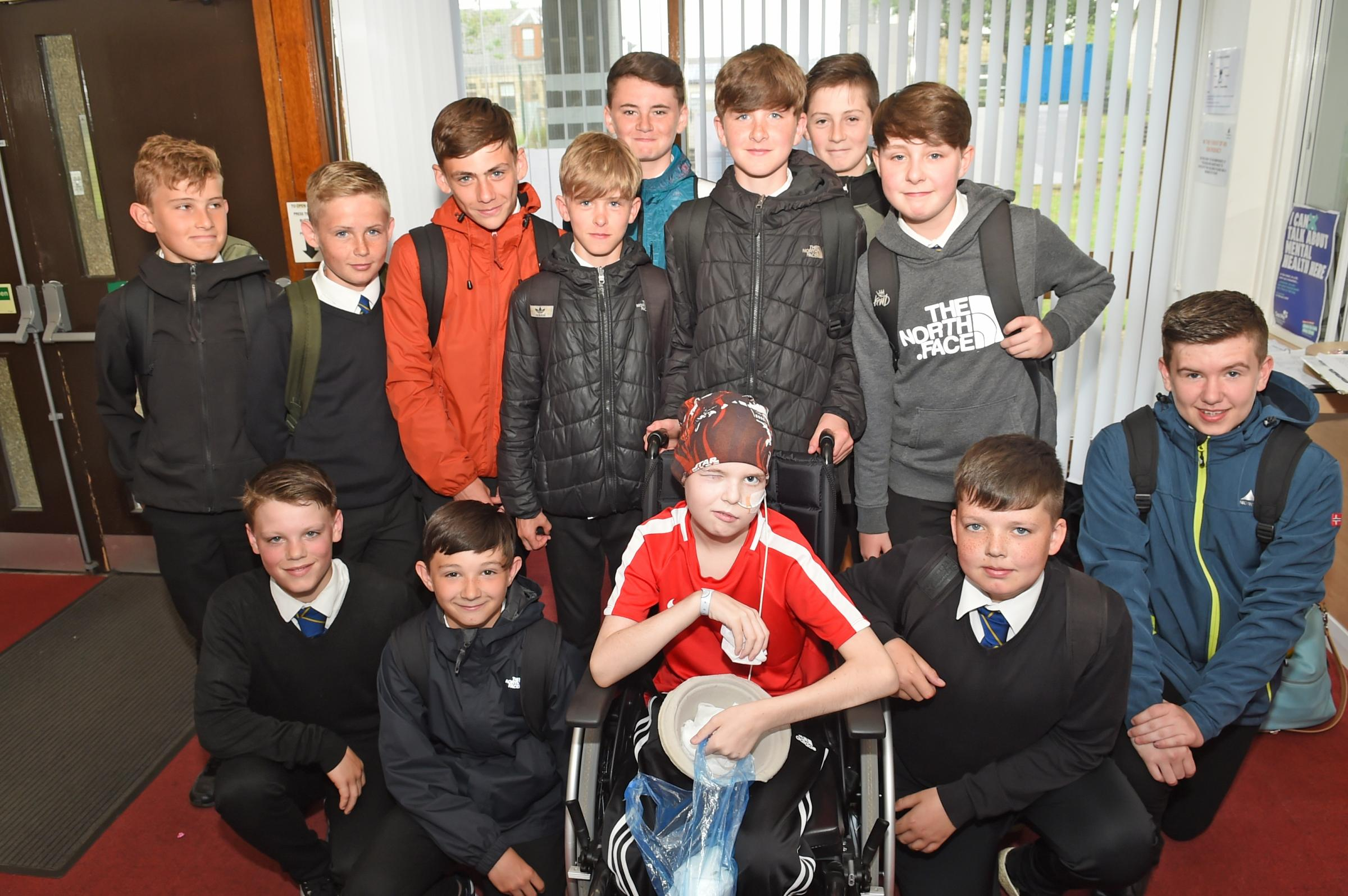Wee warrior Kieran returns to visit Kilwinning Academy