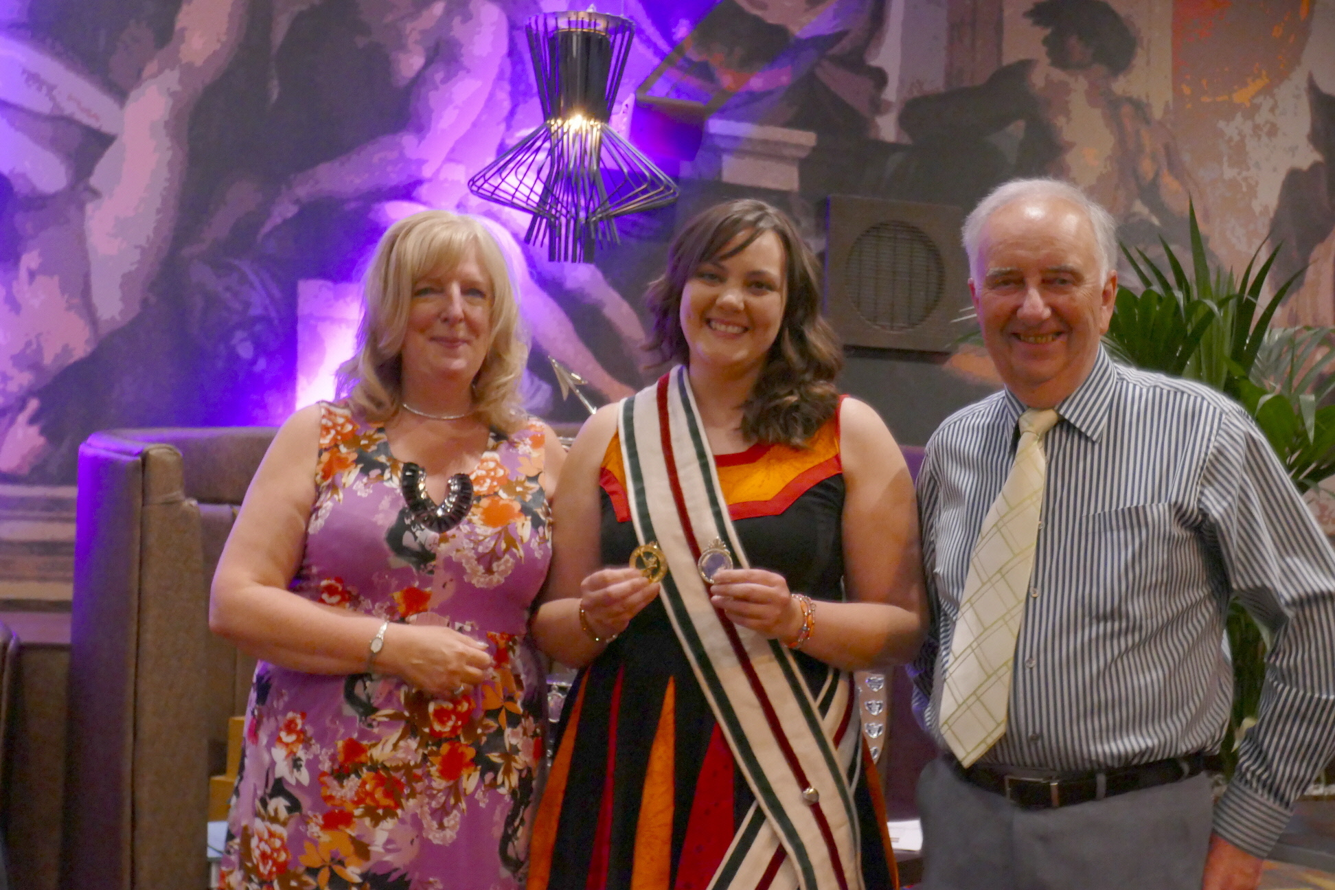 Captain Laura McHarg with Audrey Sutton on the left and Stuart Wilson the Society's President on the right