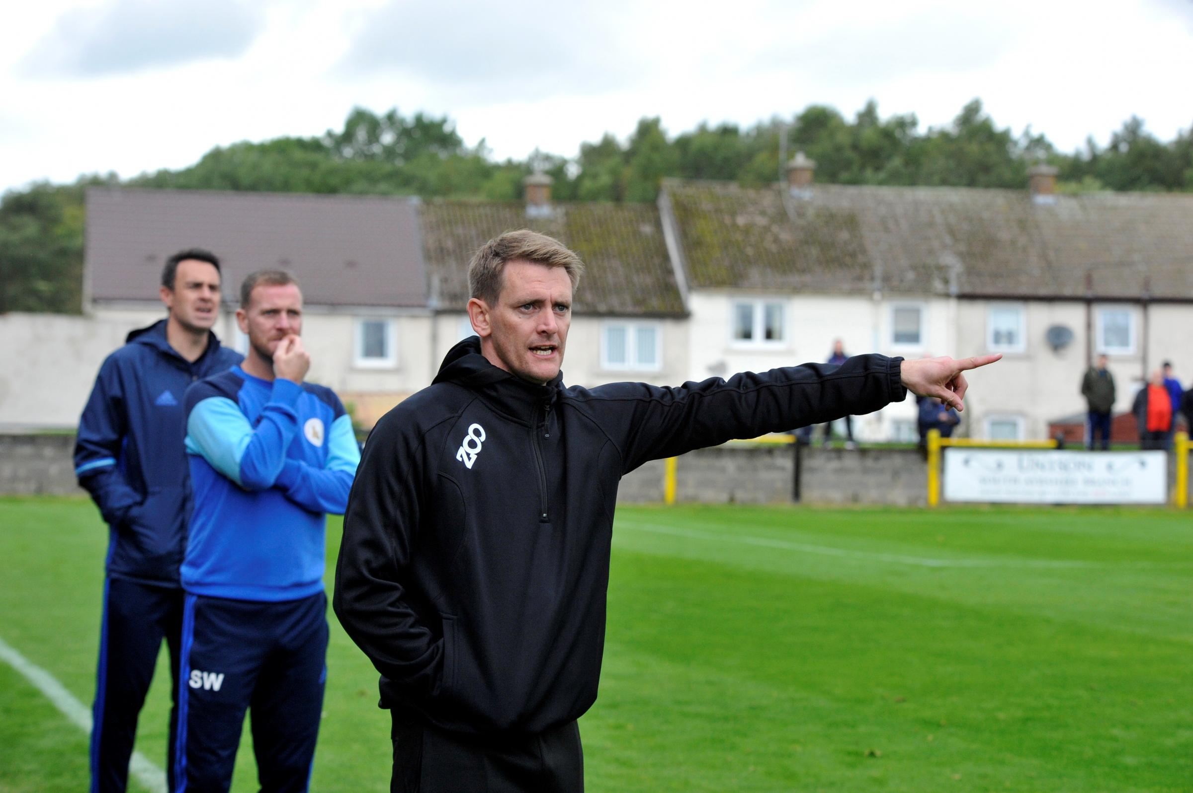 TACTICAL ADVICE: Buffs boss Chris Strain urges his players on at Beechwood Park.