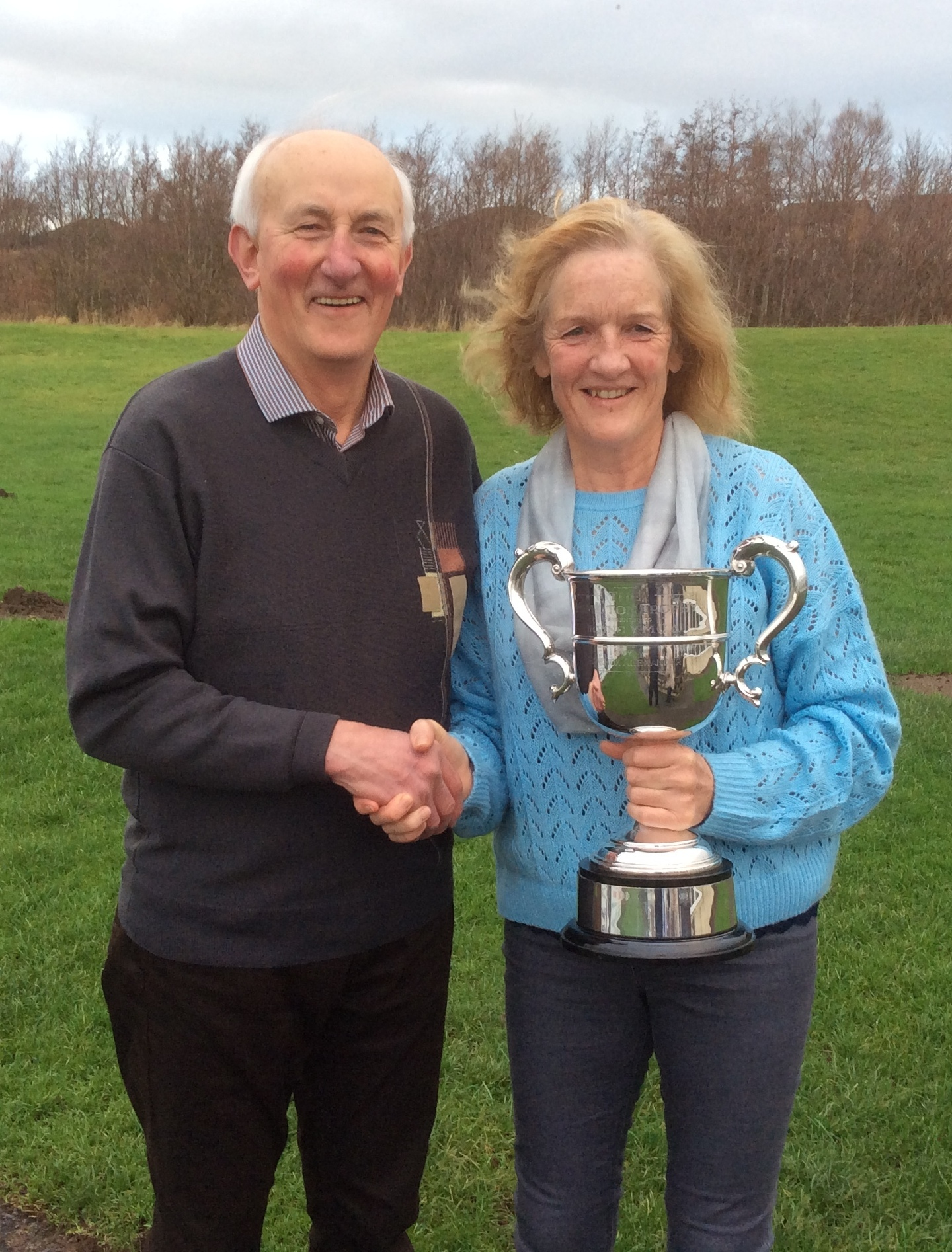 WINNING RUNNER: David King presents the Hamilton Trophy to Helen Morton