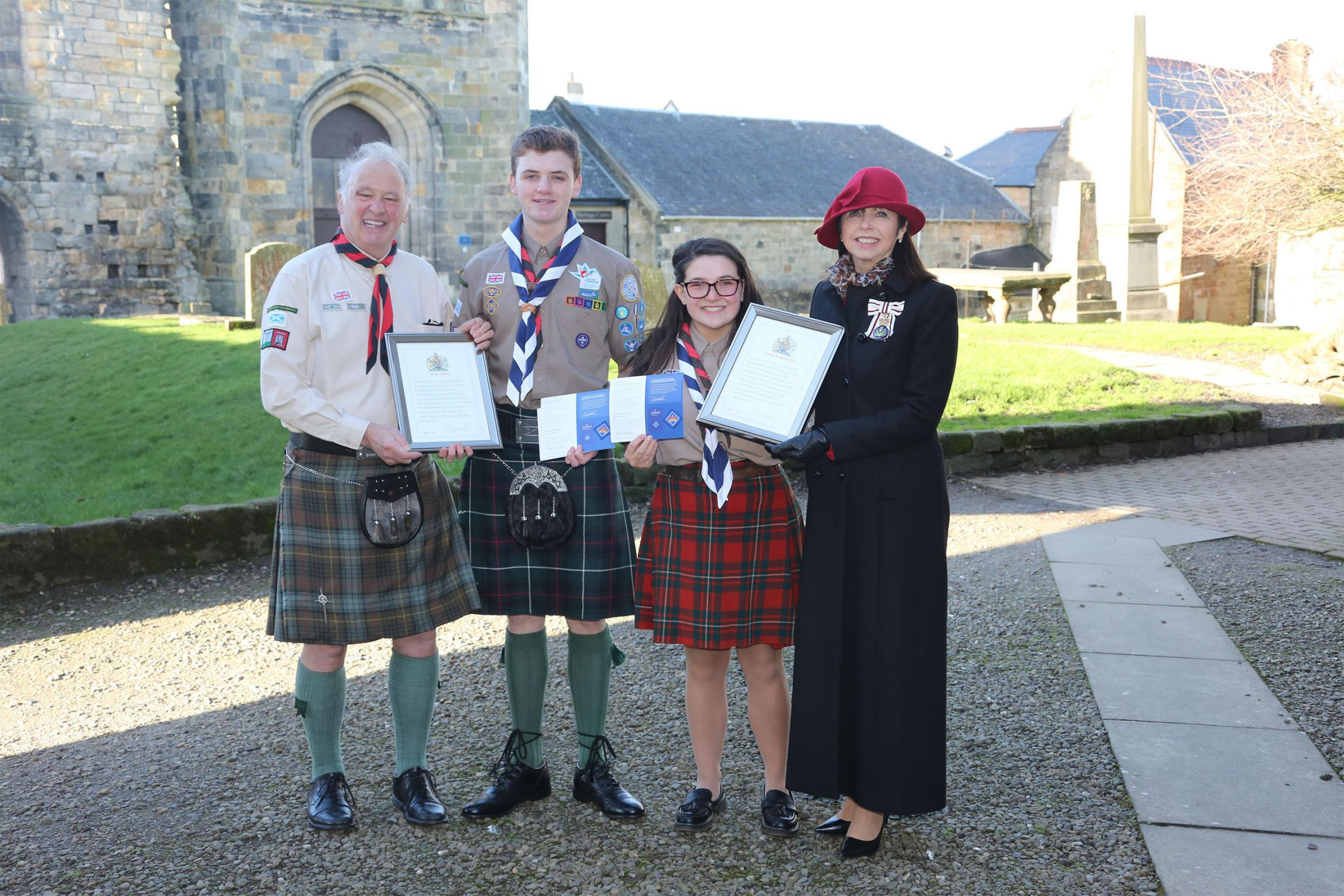 Kilwinng Abbey award to two Queen Scouts:  Scott Jeffary & Abbey Susanah Roy of 19th Ayrshire Scout group Seen here with group Scout leader Alister Kerr and Ld Lt of Ayrshire Iona Sarah MacIntyre