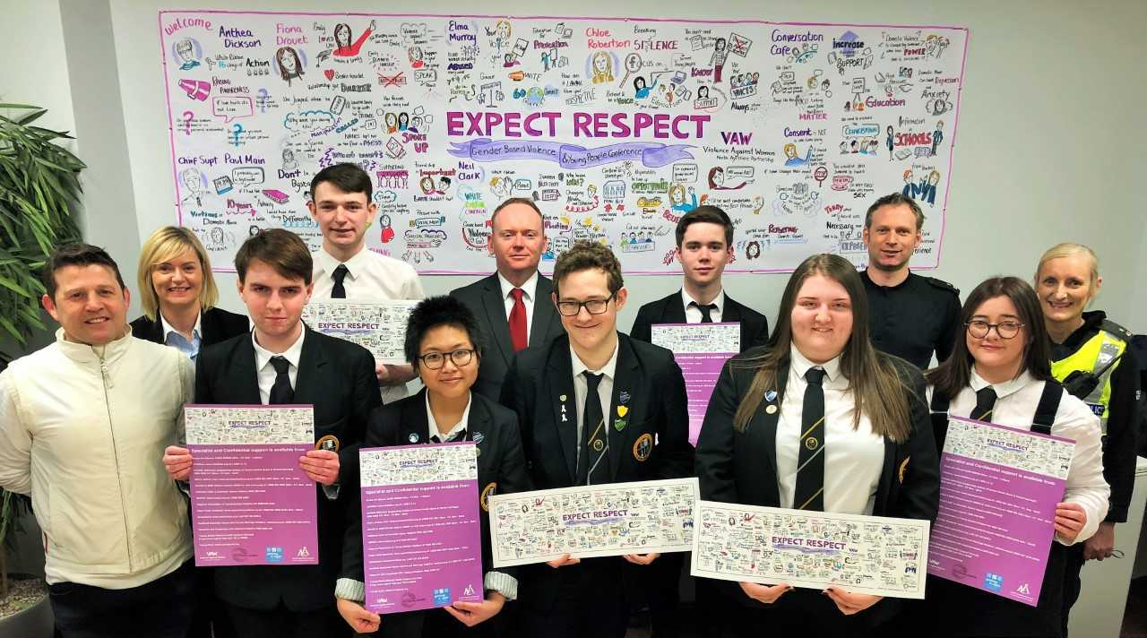 Councillor Jim Montgomerie and Police Preventions and Interventions Officer Colin Johnson with pupils from North Ayrshire and the artwork as part of the Expect Respect Conference.