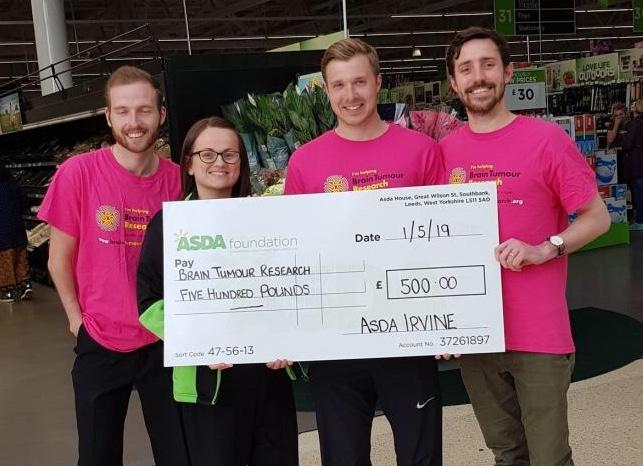 Supermarket staff raise thousands for brain tumour research with Goatfell climb