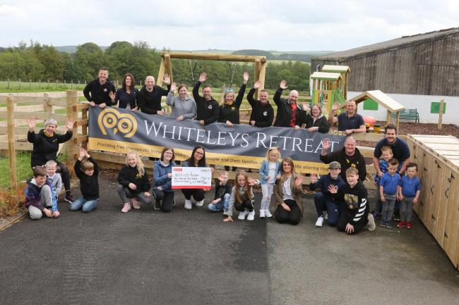 Fit Ayrshire Dads present £9,321 to Whiteleys Retreat