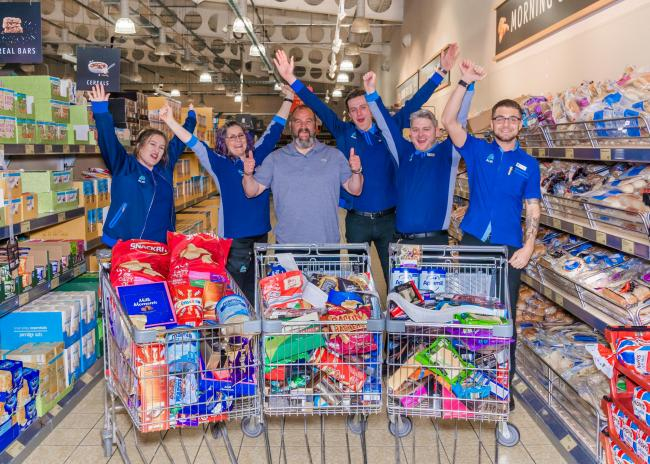 Irvine store's supermarket sweep winner raises £500 for foodbank